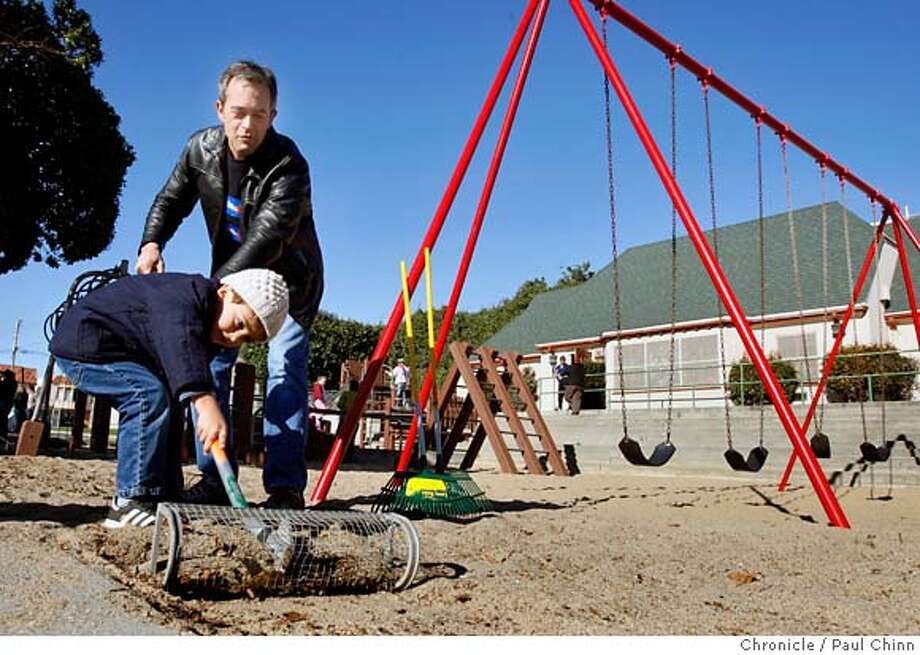 Mike Sullivan and his three-year-old son Joe remove leaves from the playground after supporters of the Proposition A bond measure kicked off the campaign at a rally at Cabrillo Playground in San Francisco, Calif. on Saturday, Dec. 8, 2007.  PAUL CHINN/The Chronicle  **Mike Sullivan, Joe MANDATORY CREDIT FOR PHOTOGRAPHER AND S.F. CHRONICLE/NO SALES - MAGS OUT Photo: PAUL CHINN