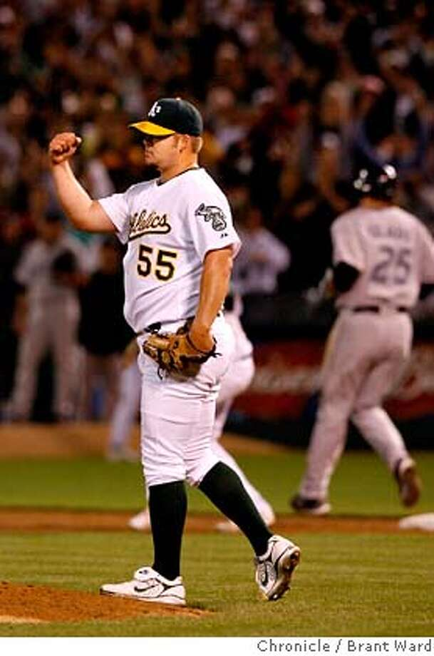 Athletics_026.JPG  Joe Blanton pumps his fist after the last out of his complete game victory.  Oakland A's vs. Toronto Blue Jays at McAfee Coliseum Tuesday night  {Brant Ward/San Francisco Chronicle}7/3/07 Ran on: 07-04-2007  Joe Blanton pumps his fist on getting Troy Glaus for the final out right after Bob Geren nearly pulled the right-hander. Photo: Brant Ward