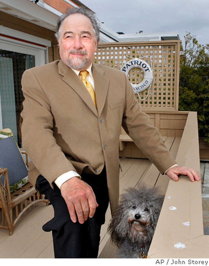 "Radio talk show host Michael Savage poses with his dog Teddy at his home in Tiburon on Monday, Dec. 3, 2007. Savage sued an Islamic civil rights group today for copyright infringement. Savage said the Washington, D.C.-based Council on American-Islamic Relations, or CAIR, violated his rights by wrongfully using a 4-minute segment of his Oct. 29 ""The Savage Nation"" show. (AP Photo/John Storey) Photo: JOHN STOREY"