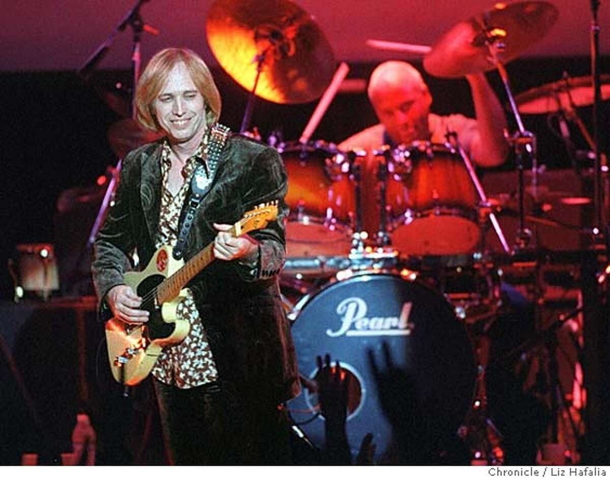 Tom Petty and the Heartbreakers in their record breaking 20 concert show run at The Fillmore. In San Francisco Liz Hafalia. Also appeared on 4/13/97 03/09/1999 CAT