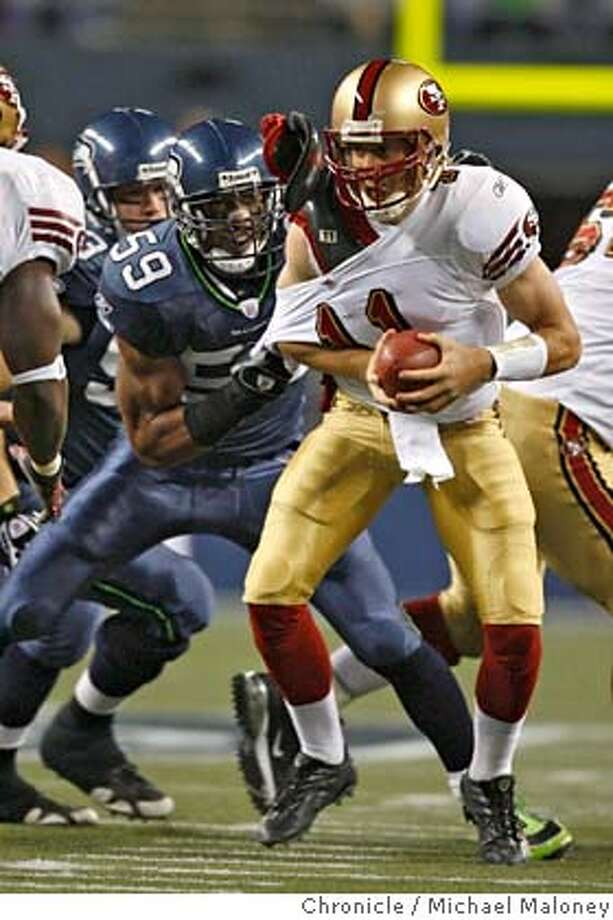 San Francisco 49ers quarterback Alex Smith (11) is sacked and nearly stripped by Seattle Seahawks Julian Peterson (59) in the 2nd quarter.  The Seattle Seahawks host the San Francisco 49ers in a Monday night football game at Qwest Fleld in Seattle.  Photo taken on 11/12/07, in Seattle, WA.  Photo by Michael Maloney / San Francisco Chronicle  ***Code replacement/roster MANDATORY CREDIT FOR PHOTOG AND SF CHRONICLE/NO SALES-MAGS OUT Photo: Michael Maloney