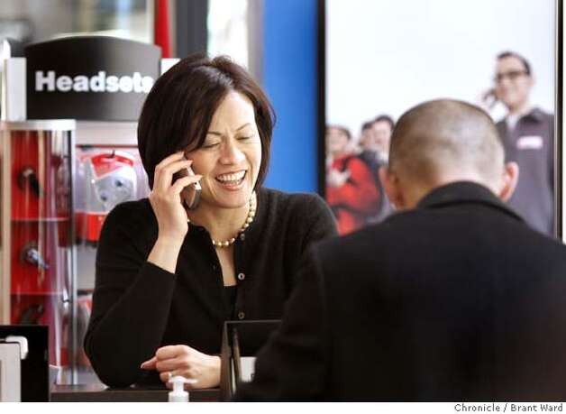 cellphone_825.JPG  Anna Hirano of San Francisco is updating her Verizon phone service at the big downtown Verizon store at Pine and Bush Streets.  Consumer Reports has come out with a comparison of cellphone plans and Verizon comes out with good scores. Wel visit a large downtown Verizon store at Pine and Battery Streets in San Francisco.  {By Brant Ward/San Francisco Chronicle}12/3/07 Photo: Brant Ward