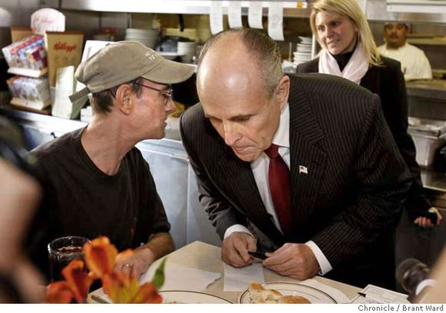giuliani_072.JPG  Rudy Giuliani, right, leaned down to hear Tom Jarvis, a visitor from Boston, as Jarvis enjoyed his meal at the Mel's Drive In counter.  Rudy Giuliani, the former New York City mayor and current Republican candidate for President, came to San Francisco Monday for a number of political events including a visit to the Mel's Drive In on Van Ness Avenue where he talked to a few diners and held a press conference.  {By Brant Ward/San Francisco Chronicle}12/10/07 Photo: Brant Ward