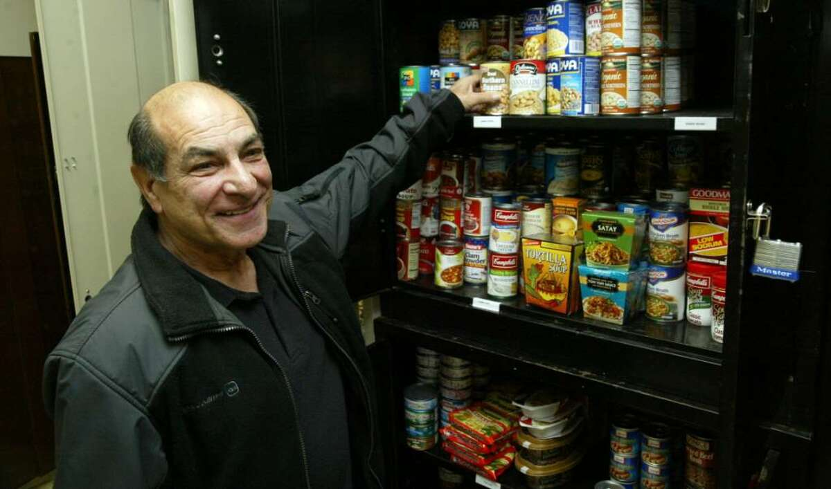 U.S. Coast Guard veteran, Vinnie Fabrizio, of Trumbull, stocks shelves while volunteering at the Bridgeport Veterans food pantry. Fabrizio and his wife Mary have donated over 800 lbs of food to the pantry since it's inception, Monday, Nov. 2, 2009.