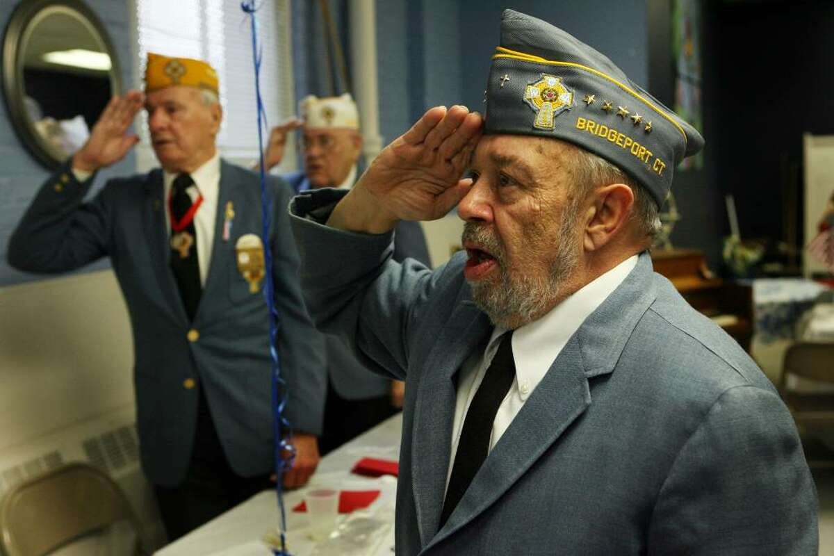 Members of the Catholic War Veterans , from left to right, Walter Stachacz, Michael Totora, and Michael Totora, Salute the Colors at the Black Rock Senior Center breakfast for veterans on Friday, Nov.6, 2009.