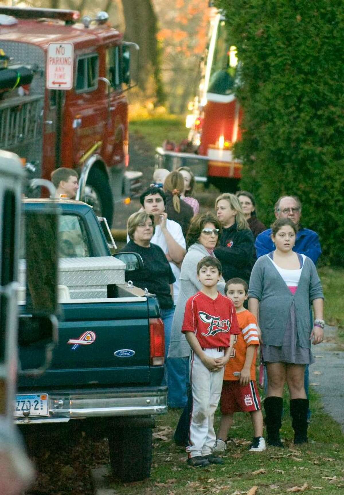 while firefighters battle a fire on Gilford St. in Stamford, Nov. 3, 2009.