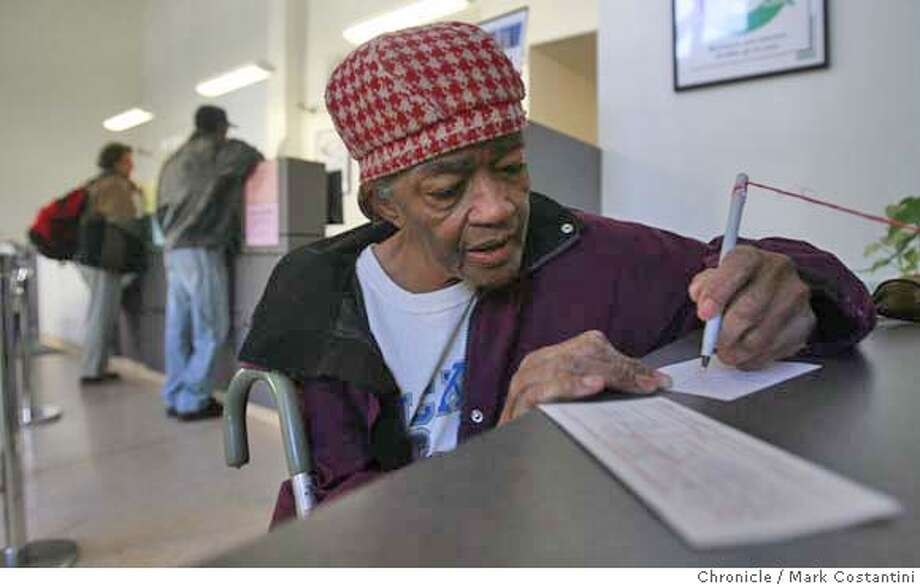 "71-year-old Virginia Johnson does some banking at her new bank.  San Francisco has created a program to help low and moderate income people open checking accounts. These accounts save people gobs of money because most of the ""unbanked"" previously used check cashing outlets to do their business (cash checks, mail money orders, etc.) which cost some people hundreds of dollars a month in fees, not to mention the danger in walking out of these places with wads of cash. The program has been wildly successful, with more than 11,000 people opening accounts in the first year. One of those, 70-year-old Virginia Johnson, saves about $200 a month with her new account. Her caregiver Roy Miller has helped about a half dozen of his clients open accounts. We're meeting Johnson and Miller at her apartment and the plan is for them to show us where she cashed her checks and her new bank, which are all in close proximity. Mark Costantini / The Chronicle Photo taken on 11/30/07, in San Francisco, CA, USA MANDATORY CREDIT FOR PHOTOG AND SAN FRANCISCO CHRONICLE/NO SALES-MAGS OUT Photo: Mark Costantini"