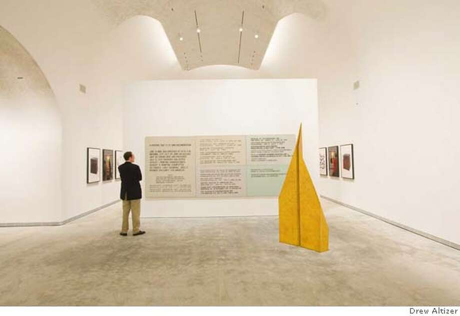 "Alex Hay  Paper Airplane  1968  fiberglass, epoxy, spray lacquer, and stencil on paper Work on wall is  John Baldessari  A Painting That Is Its Own Documentation  1966-1968  Acrylic on multiple canvases The work in the very background, behind that wall is  Keith Tyson  The Block (part of ""Seven Wonders of the World"" series)  2007  Bronze casting and framed photos Photo: Ho"