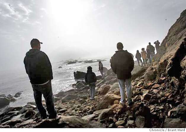 mavericks_833.JPG  Near the end of the beach, a small crowd tried to catch a glimpse of surfers, but no one said they saw one.  Crowds wandered through the fog at what they call Marvericks Beach Tuesday afternoon. The fog was so thick that viewing surfers was very difficult. {By Brant Ward/San Francisco Chronicle}12/4/07 Photo: Brant Ward