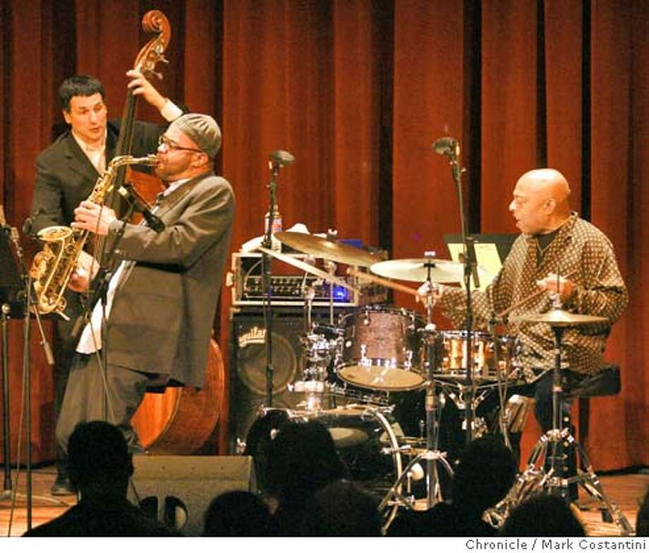 (from left) John Pattitucci, Kenny Garrett and Roy Haynes.  Opening night of Yoshi's, a big new jazz club in San Francisco. All-star band of drummer Roy Haynes inaugurates it. Mark Costantini / The Chronicle Photo taken on 11/28/07, in San Francisco, CA, USA Photo: Mark Costantini