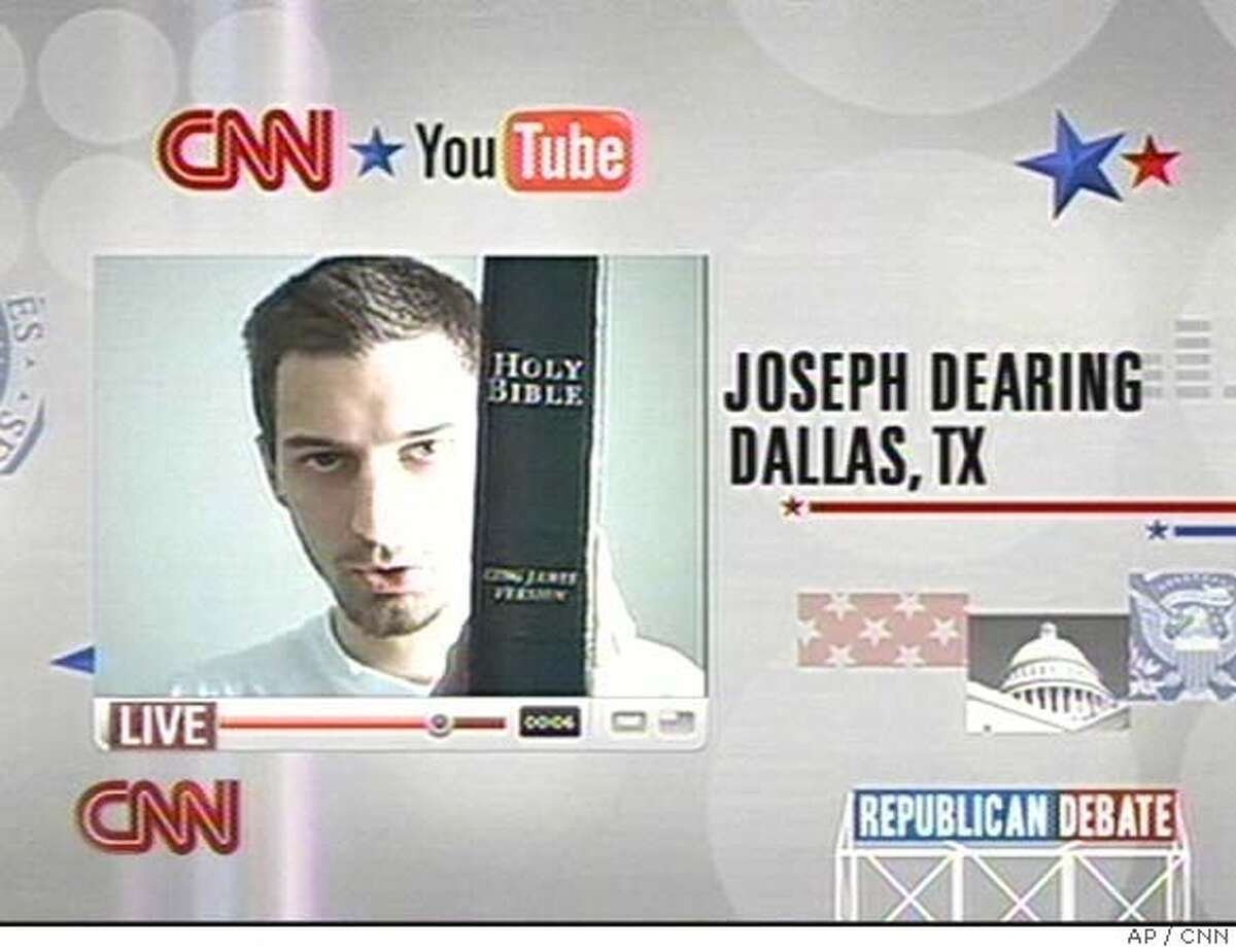 In this image taken from CNN, Joseph Dearing of Dallas, Texas, holds a copy of the Bible as he poses a question to Republican presidential hopefuls during the CNN and YouTube debate in St. Petersburg, Fl., Wednesday, Nov. 28, 2007. Republican presidential candidates are facing off in St. Petersburg in the CNN and YouTube debate. People from across the country have submitted more than 3,500 videos posing questions and about 40 are to be broadcast. (AP Photo/CNN) ** IMAGE MUST BE USED IN ITS ENTIRETY, NO SALES, TV OUT ** IMAGE MUST BE USED IN ITS ENTIRETY, NO SALES, TV OUT, NO ACCESS JAPAN