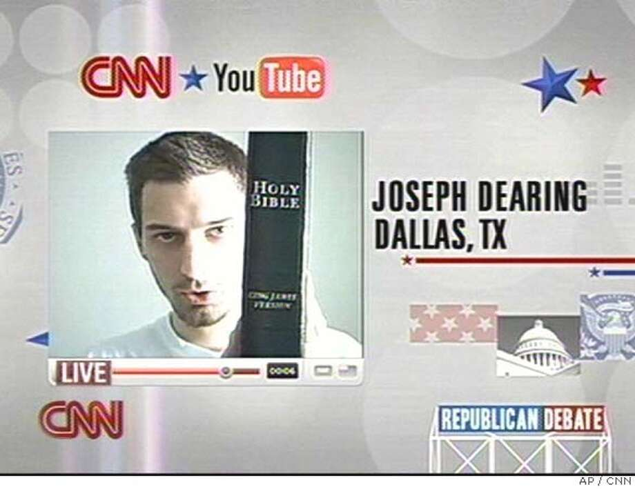 In this image taken from CNN, Joseph Dearing of Dallas, Texas, holds a copy of the Bible as he poses a question to Republican presidential hopefuls during the CNN and YouTube debate in St. Petersburg, Fl., Wednesday, Nov. 28, 2007. Republican presidential candidates are facing off in St. Petersburg in the CNN and YouTube debate. People from across the country have submitted more than 3,500 videos posing questions and about 40 are to be broadcast. (AP Photo/CNN) ** IMAGE MUST BE USED IN ITS ENTIRETY, NO SALES, TV OUT ** IMAGE MUST BE USED IN ITS ENTIRETY, NO SALES, TV OUT, NO ACCESS JAPAN Photo: Ho