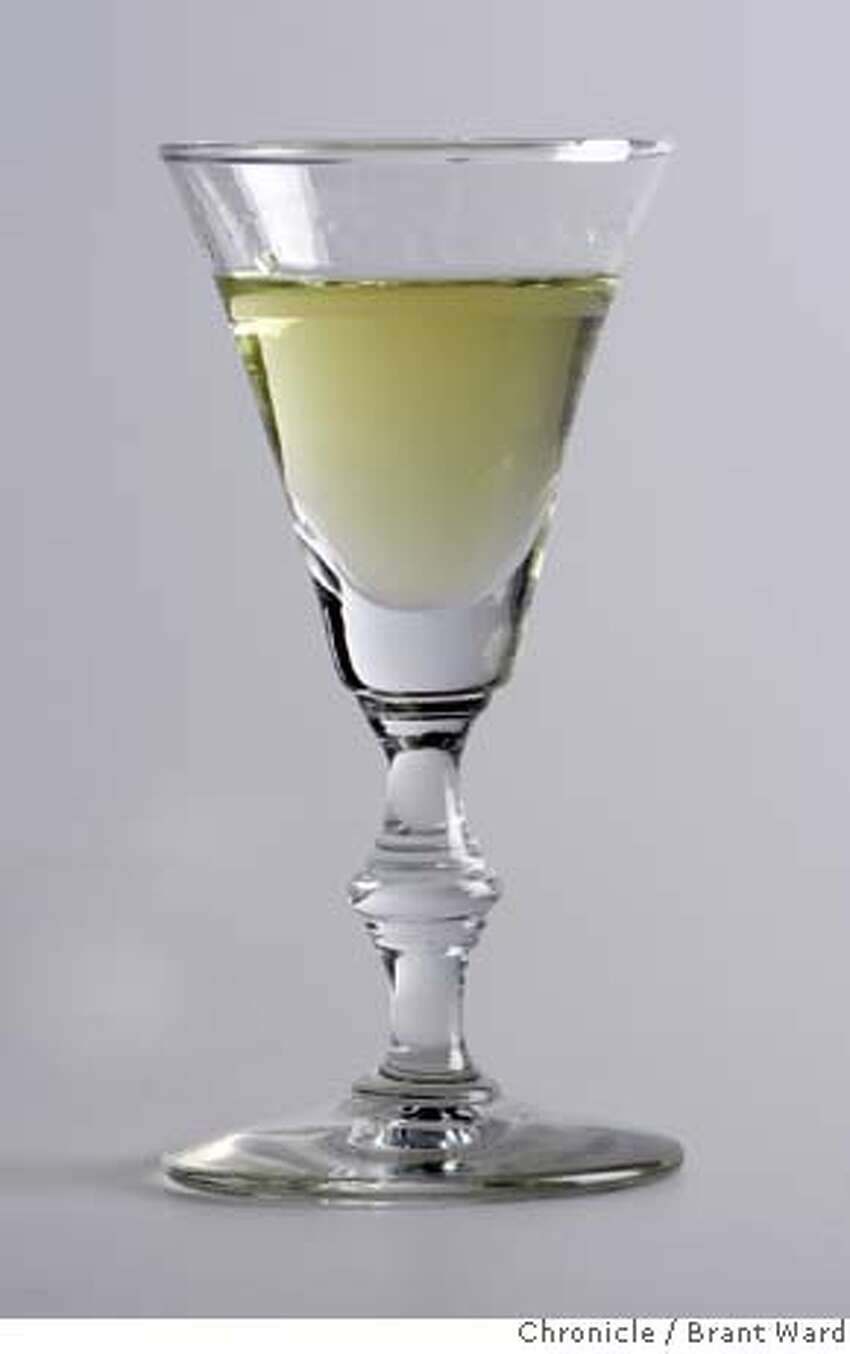 absinthe_836.JPG A glass of absinthe photographed at the Chronicle studio. One glass also contains sugar which clouds the liquor. {By Brant Ward/San Francisco Chronicle}12/4/07