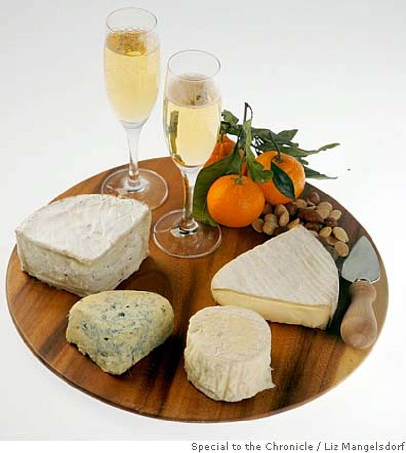 cheese30_027_lm.jpg  Four cheeses, including Edel de Cleron, LaTur, Truffle Tremor and Cashel blue, for the Bubbly Issue.  Photo by Liz Mangelsdorf, Special to the Chronicle Event on 11/24/07 in San Francisco. MANDATORY CREDIT FOR PHOTOG AND SF CHRONICLE/NO SALES-MAGS OUT Photo: Liz Mangelsdorf