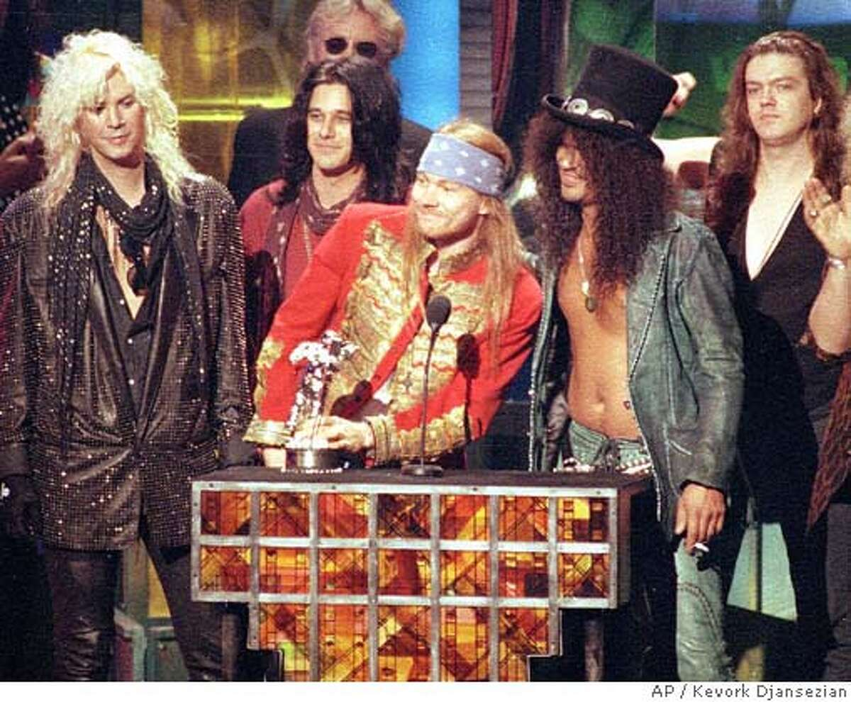 """** FILE ** Guns N' Roses, from left, Michael """"Duff"""" McKagan, Dizzy Reed, Axl Rose, Saul """"Slash"""" Hudson and Matt Sorum, receives the Michael Jackson Video Vanguard Award for """"November Rain"""" at the MTV Video Music Awards ceremony in Los Angeles, Ca., on Sept. 9, 1992. """"Slash"""" and """"Duff"""" have sued frontman Axl Rose for allegedly naming himself sole administrator of the group's copyrights. The suit was filed Aug. 17, 2005 in Los Angeles. (AP Photo/Kevork Djansezian, File)"""