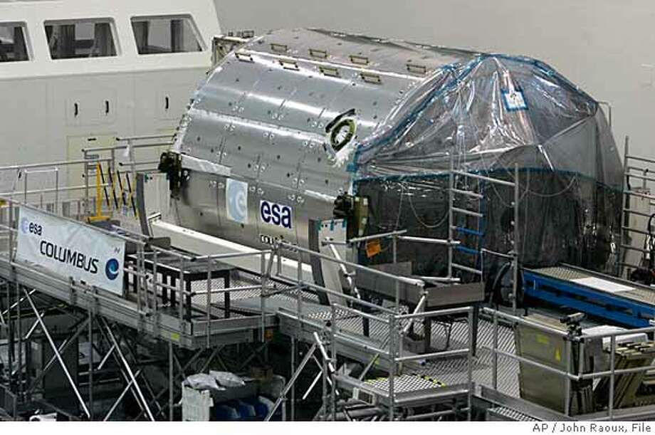 ** ADVANCE FOR SUNDAY, DEC. 2 ** ** FILE ** The space lab Columbus waits for installation for the next space shuttle launch in the Space Station Processing Facility at the Kennedy Space Center in Cape Canaveral, Fla., in this Oct. 31, 2007 file photo. (AP Photo/John Raoux, File) HFR SUNDAY, DEC. 2, 2007. AN OCT. 31, 2007 FILE PHOTO. Photo: John Raoux