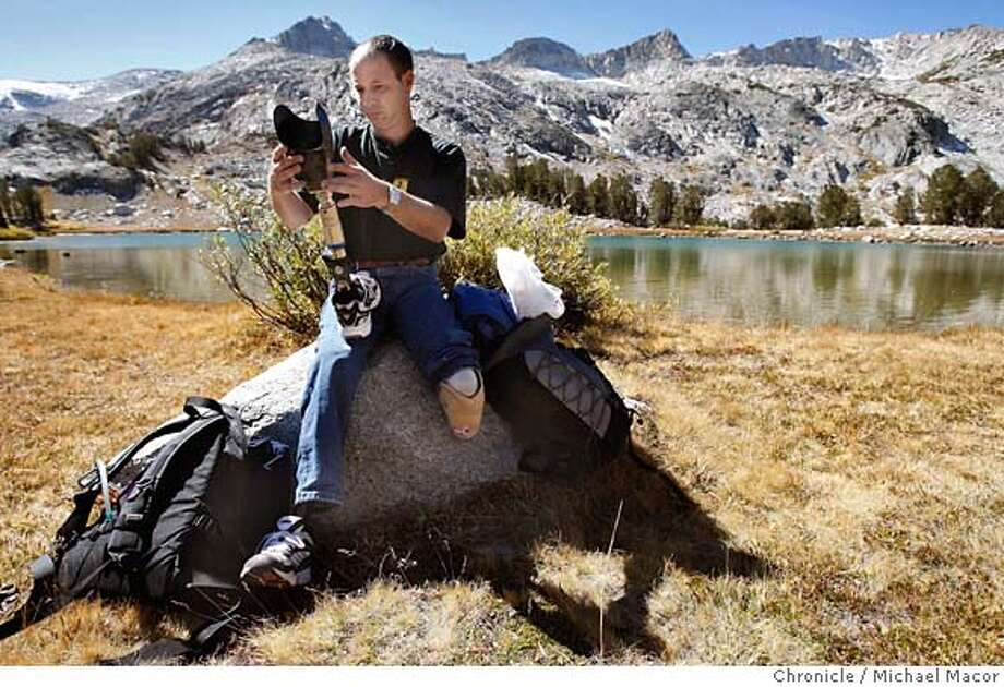 rescue_433_mac.jpg Donnie Priest adjusts the settings of his prosthetic leg. Priest on his trek to the crash site, stopped about 1,000 feet short of the scene. The site is in the background over his left shoulder. 25 years ago a small plane crashed on a mountain just outside Yosemite in the middle of the winter. By the time rescuers found it, five days later, the only survivor was a 10-year-old boy whose lower legs were black with frostbite. Recently the survivor, Donnie Priest, tracked down his rescuers. They're meeting to hike into the crash site and talk about what happened. Priest will be walking in on artificial legs. Photographed in, Tioga Pass, Ca, on 9/29/07. Photo by: Michael Macor/ The Chronicle Mandatory credit for Photographer and San Francisco Chronicle No sales/ Magazines Out Photo: Michael Macor