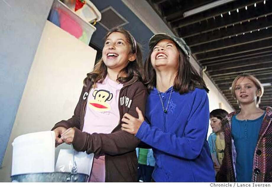 BIRDS_84031.JPG  Sofia Suarez age 10 and Haley Gee (with hat) age 9 take turns with the bucket that weights in at almost ten pounds. It�s full of bills and coins as the girls walk through the halls of Berkeley's Montessori School Tuesday. Motivated by the Cosco Busan disaster, animal lover Haley Gee, 9, from Berkeley's Montessori School, got a bucket and started asking everyone she met for donations to help International Bird Rescue Research Center�s year-round efforts treating injured and orphaned aquatic birds and waterfowl. She and her classmates, including her sister and six close friends formed a club called the Save our Birds. After the group raised over $450.00, turning the money over to IBRRC The Rescue directors have created a new special fund called Haley's Bird Rescue Fund. All monies donated will be used toward treating the thousands of birds IBRRC treats every year. Lance Iversen/The Chronicle (cq) SUBJECT 11/20/07,in Berkeley and Cordelia Ca. MANDATORY CREDIT PHOTOG AND SAN FRANCISCO CHRONICLE/NO SALES MAGS OUT Photo: Lance Iversen
