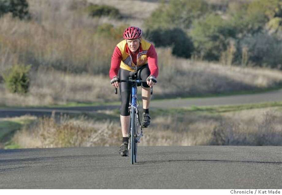 PLEASE USE ONLY ONE FROM THIS SHOOT...DJ NSURANCE20_002_KW.JPG  On November 19, 2007, Kent Odell, 56, who tries to ride 100 miles on his bike each week, rides through Benicia State Park in Benicia. Odell, who quit smoking sixteen years ago, is one of many in the 50 - 65-year-old range who has trouble getting affordable individual health insurance regardless of his lack of health problems.  Photo by Kat Wade Photo: Kat Wade