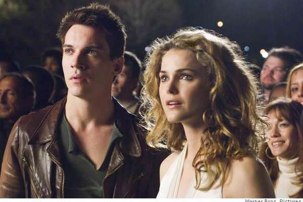 """This undated photo provided by Warner Bros. Pictures shows Jonathan Rhys Meyers (Left) starring as Louis Connelly and Keri Russell as Lyla Novacek in """"August Rush."""" (AP Photo/Warner Bros.)"""