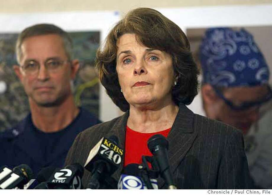 U.S. Senator Dianne Feinstein speaks at a news conference after she was briefed on the progress of the oil spill clean-up efforts by Coast Guard Rear Admiral Craig Bone (left) and other officials at the unified command center on Treasure Island in San Francisco, Calif. on Sunday, Nov. 11, 2007. earlier in the week Feinstein harshly criticized the apparent slow response by the Coast Guard to the accident but she backed off those remarks at a news conference.  PAUL CHINN/The Chronicle  **Dianne Feinstein, Craig Bone MANDATORY CREDIT FOR PHOTOGRAPHER AND S.F. CHRONICLE/NO SALES - MAGS OUT Photo: PAUL CHINN