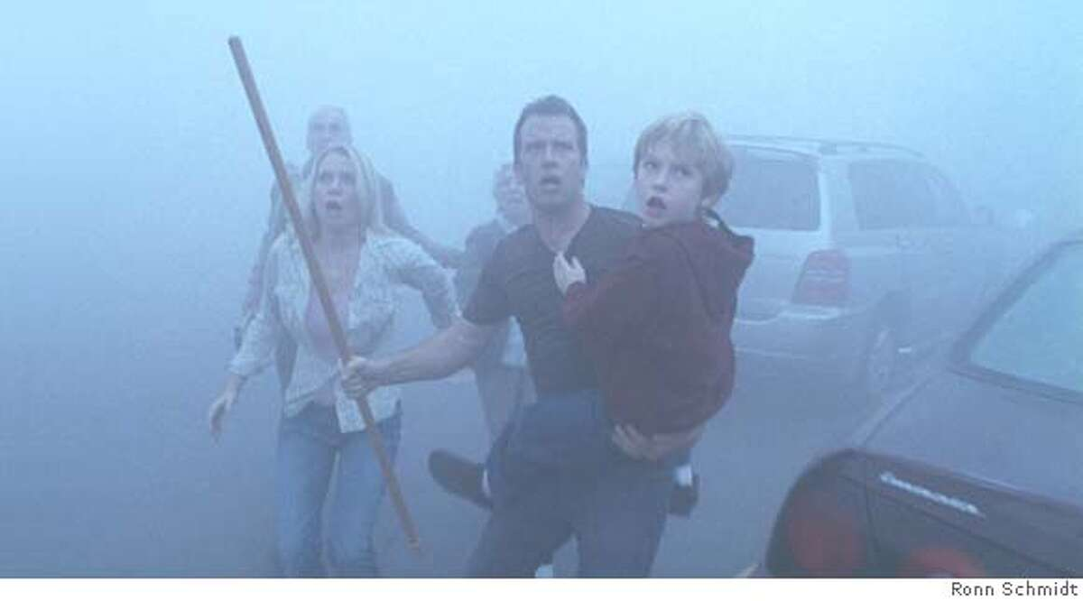 Laurie Holden, Thomas Jane and Nathan Gamble star in Frank Darabont's adaptation of Stephen King's The Mist. Ran on: 11-21-2007 Laurie Holden, Thomas Jane and Nathan Gamble in The Mist.
