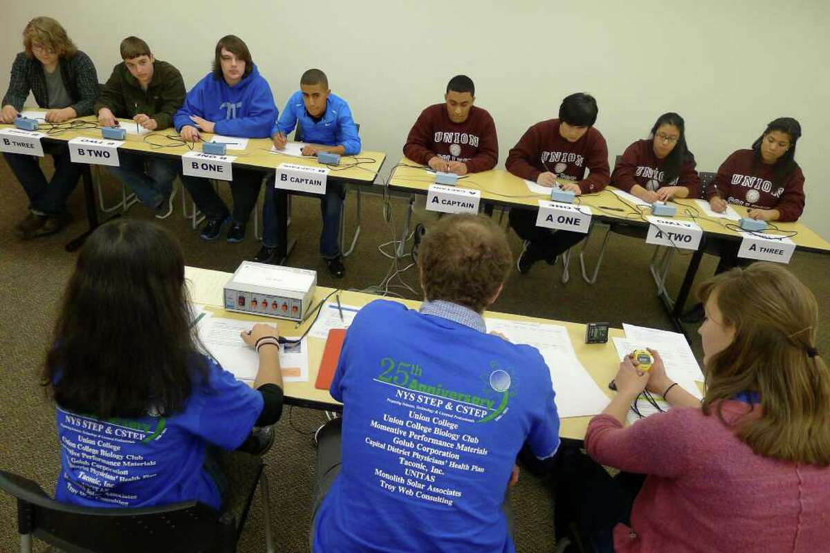 Teams from SUNY Fredonia,left, and Union College face off during the STEP Regional Science Bowl at Union College in Schenectady, New York Saturday Feb.11, 2012.( Michael P. Farrell/Times Union)