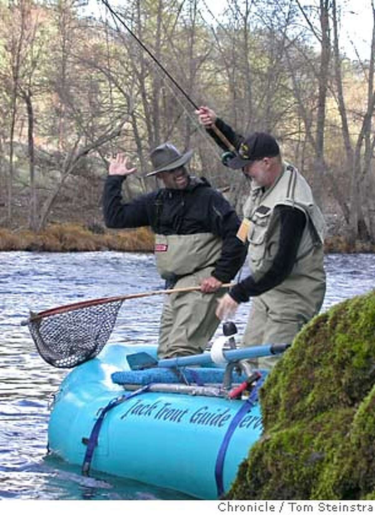Guide Jack Trout and John Lescroart net steelhead on Trinity River. Tom Steinstra / The Chronicle MANDATORY CREDIT FOR PHOTOG AND SAN FRANCISCO CHRONICLE/NO SALES-MAGS OUT