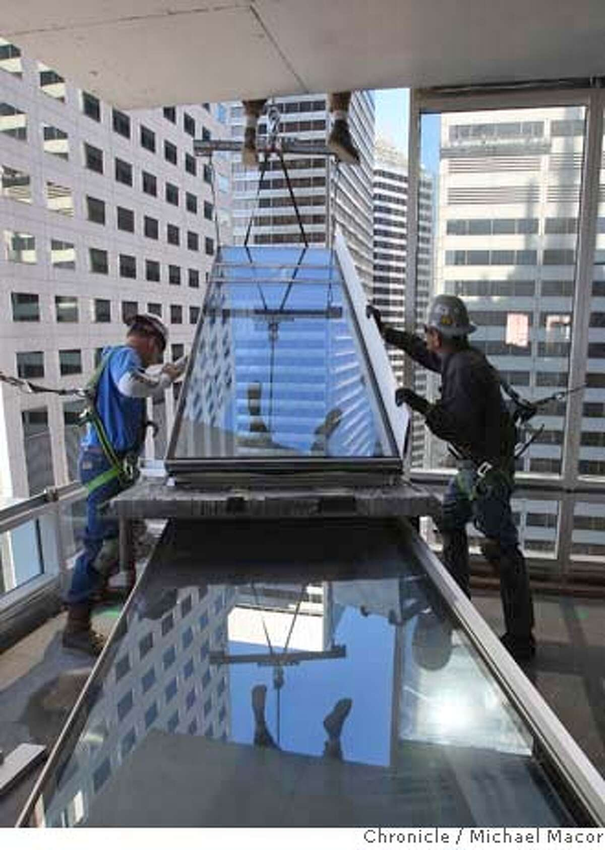 glass_slideshow_134_mac.jpg Greg Gardner, Scott Brown move a pane intoplace with the help of Mike Hepsley above. The Millennium Tower. A spate of new glass towers in San Francisco that could add up to a much different skyline from the south - one that boosters say will be gleaming and new, but detractors fear could be a bad flashback to 1980s Miami. Michael Macor / The Chronicle Photo taken on 10/11/07, in San Francisco, CA, USA Ran on: 11-26-2007 301 Mission St., one of the new glass high-rises, is reflected in the facade of a neighboring glass tower at 210 Mission St.