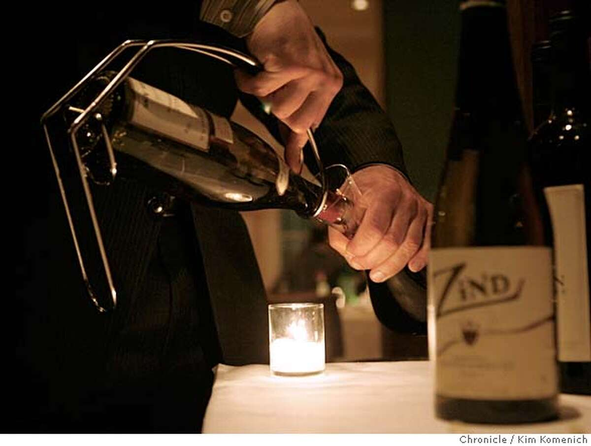 ESSENTIALS09_020_KK.JPG Rubicon sommelier Cezar Kusik (CQ) is responsible for guiding customers' wine choices in all its dining rooms. Here he decants some wine. Photo by Kim Komenich/The Chronicle **Cezar Kusik ** MANDATORY CREDIT FOR PHOTOG AND SAN FRANCISCO CHRONICLE. NO SALES- MAGS OUT.