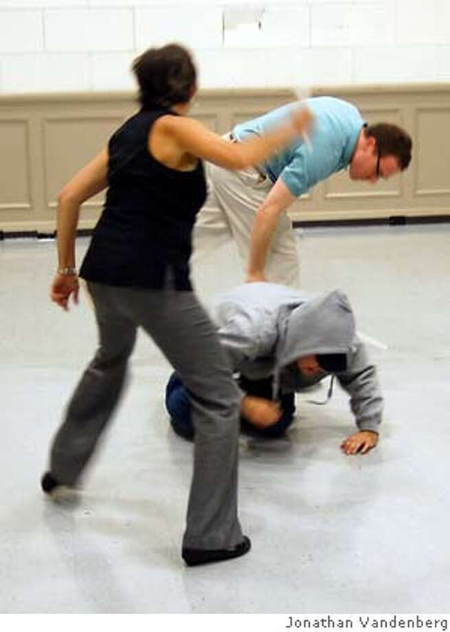 """No Such Thing"" rehearsal. Actors: Cristina Arrióla, Andrew Nolan (kneeling), Bob Lieberman. Photo: Jonathan Vandenberg"