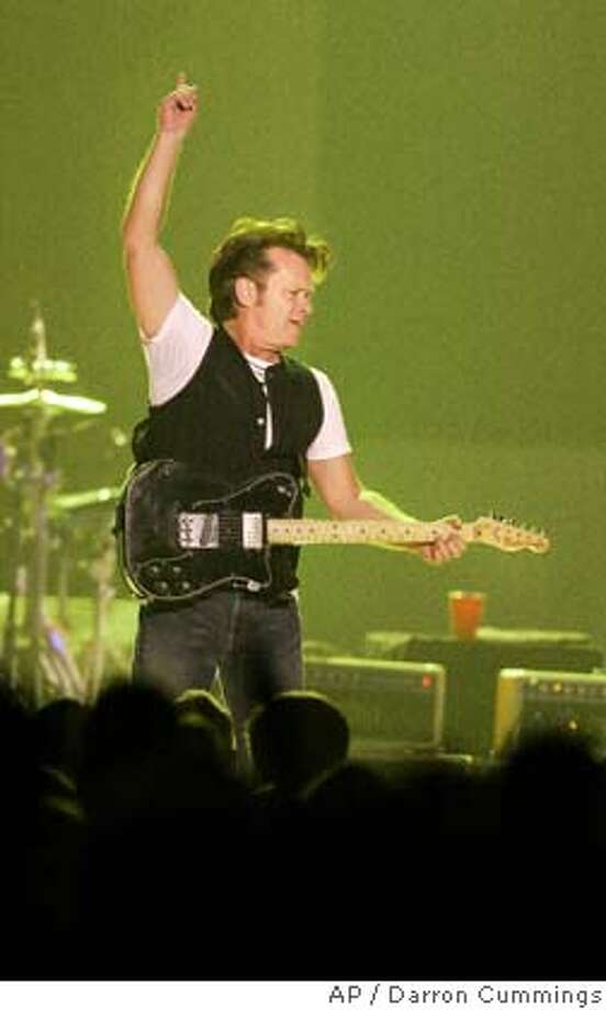 John Mellencamp performs at Conseco Fieldhouse, Saturday, Nov. 3, 2007 in Indianapolis in Indianapolis, the second Indianapolis performance of his fall concert tour. (AP Photo/Darron Cummings) Photo: Darron Cummings