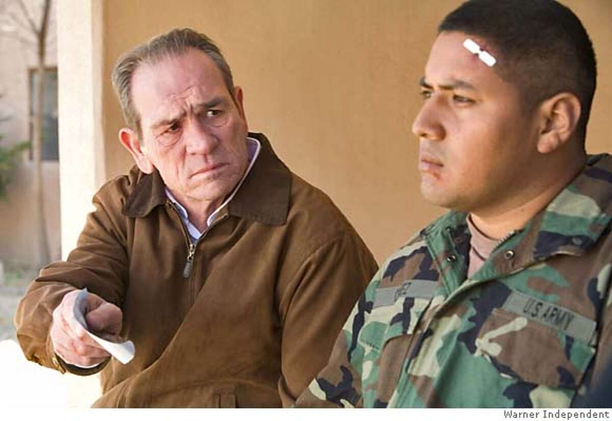 This undated photo, supplied by Warner Independent, shows Tommy Lee Jones and Victor Wolf, right, in director Paul Haggis In the Valley of Elah, a Warner Independent Pictures release. The film, one in a wave of films that examine severe U.S. tactics, troubled homecomings for U.S. veterans and the conflicts faced by troops hurled into urban warfare in Iraq, is being shown at the Toronto Film Festival.(AP Photo/Warner Independent, Lorey Sebastian) Ran on: 09-13-2007 Paul Haggis, Tommy Lee Jones and Julie Taymor talk about their films at a news conference in Toronto. NO SALES, UNDATED PHOTO SUPPLIED BY WARNER INDEPENDENT