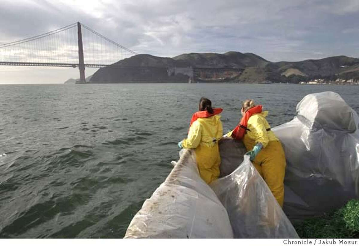 Spill_CrabBoat_16_JMM.JPG Marylou Lopez and Shanna Kelly, both with the North West Fire Fighters, cast out plastic pompoms to suck up oil while riding on John Mellor's fishing boat near Golden Gate Bridge in an effort to help clean up the San Francisco Bay after the Cosco Busan oil spill on Monday November 12, 2007. Event on 11/12/07 in Tiburon. Jakub Mosur / The Chronicle MANDATORY CREDIT FOR PHOTOG AND SF CHRONICLE/NO SALES-MAGS OUT