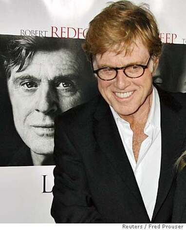 "Actor Robert Redford, star of the film ""Lions for Lambs"", poses as he arrives for a screening of the film he also directed at the opening of the AFI Fest 2007 film festival in Hollywood November 1, 2007. REUTERS/Fred Prouser (UNITED STATES) 0 Photo: FRED PROUSER"