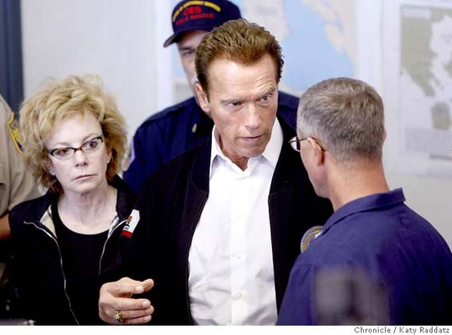 SPILL_GOV  Arnold Schwarznegger (C) listens intently to Coast Guard Rear Admiral Craig Bone (R) explain what happened immediately after the spill. Carole Migden is on the LEFT. Governnor Arnold Schwarznegger visits Treasure Island to be briefed by the Coast Guard and give another photo op. These pictures were made on Tuesday Nov.13, 2007, in Treasure Island, CA.  KATY RADDATZ/The Chronicle Photo taken on 11/13/07, in Treasure Island, CA, USA Photo: KATY RADDATZ
