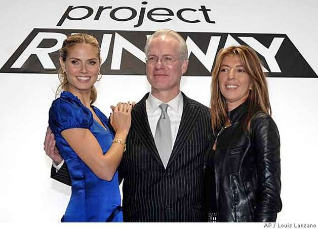 "Panelists supermodel Heidi Klum, left, Tim Gunn and Nina Garcia pose for photographers following the presentation of fashions by fifteen designers competing for the top designer award on the ""Project Runway"" TV reality show, Tuesday, Nov. 6, 2007, in New York. (AP Photo/Louis Lanzano) Photo: LOUIS LANZANO"