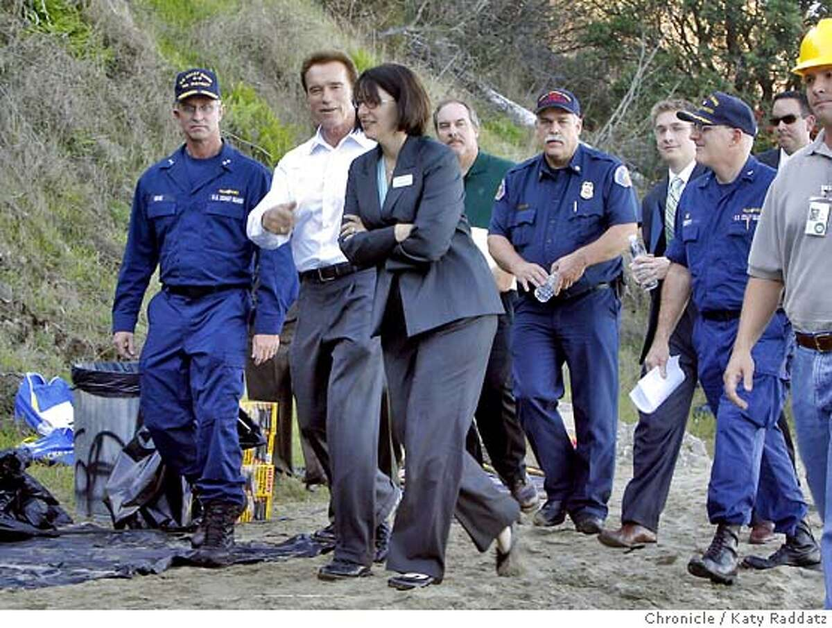 SPILL_GOV Governor Arnold Schwarznegger leaves Clipper Cove Beach after the second part of his photo op where he wanted to be photographed with the hazmat private contractors cleaning the beach. Governnor Arnold Schwarznegger visits Treasure Island to be briefed by the Coast Guard and give another photo op. These pictures were made on Tuesday Nov.13, 2007, in Treasure Island, CA. KATY RADDATZ/The Chronicle Photo taken on 11/13/07, in Treasure Island, CA, USA