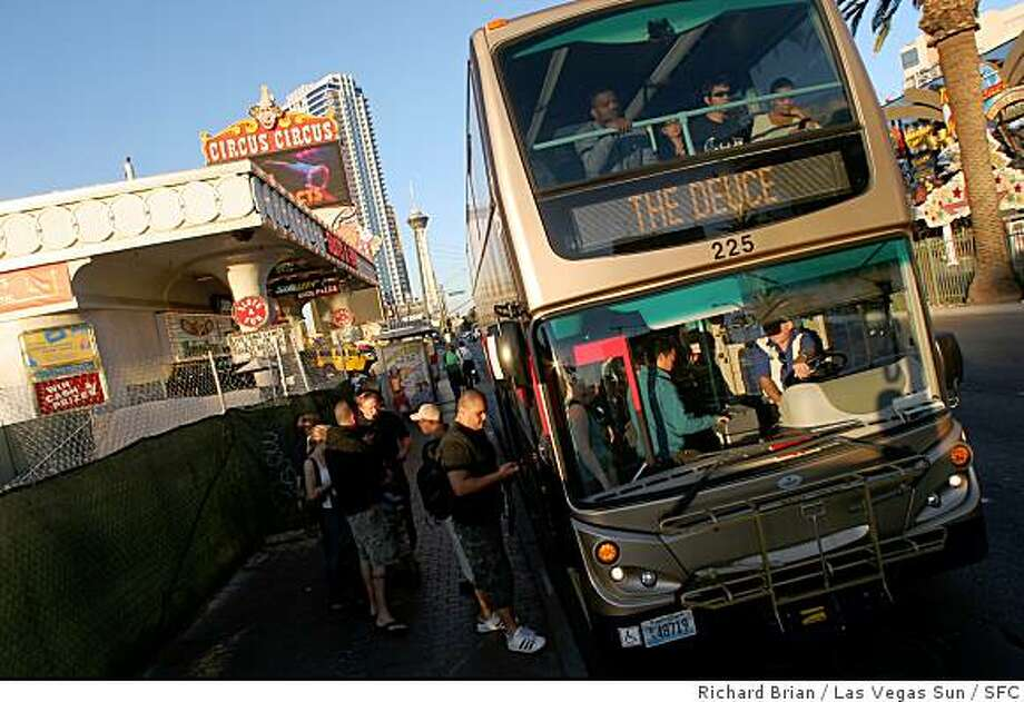 People board the Double Deuce tour bus on Las Vegas Boulevard, Las Vegas. Photo: Richard Brian / Las Vegas Sun, SFC