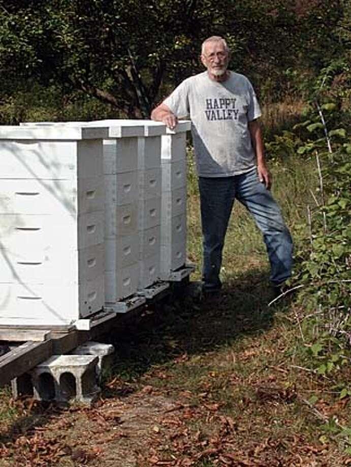 John McDonald by the Centre County bee hives  OLYMPUS DIGITAL CAMERA Photo: Handout