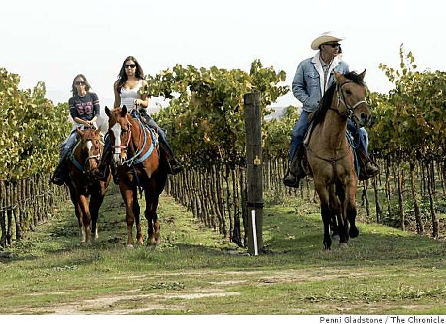 At the Larson Family Winery, Rafael Hernandez in the cowboy hat takes children and adults on horseback or wagon rides through the vineyards. He started the concept in 1999. Photo: Penni Gladstone, The Chronicle