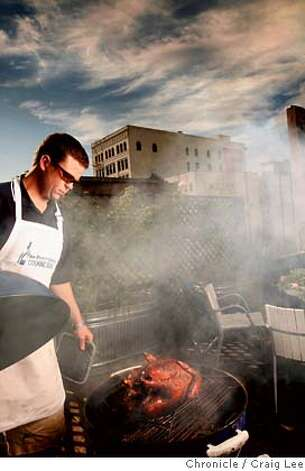 TURKEYCAMP14_588_cl.JPG  Photo of the San Francisco Chronicle's Food section Turkey Training Camp. Photo of Marker Lovell checking his roast turkey in his BBQ grill on top of the roof. The turkey was done.  on 11/4/07 in San Francisco. photo by Craig Lee / The Chronicle MANDATORY CREDIT FOR PHOTOG AND SF CHRONICLE/NO SALES-MAGS OUT Photo: Photo By Craig Lee