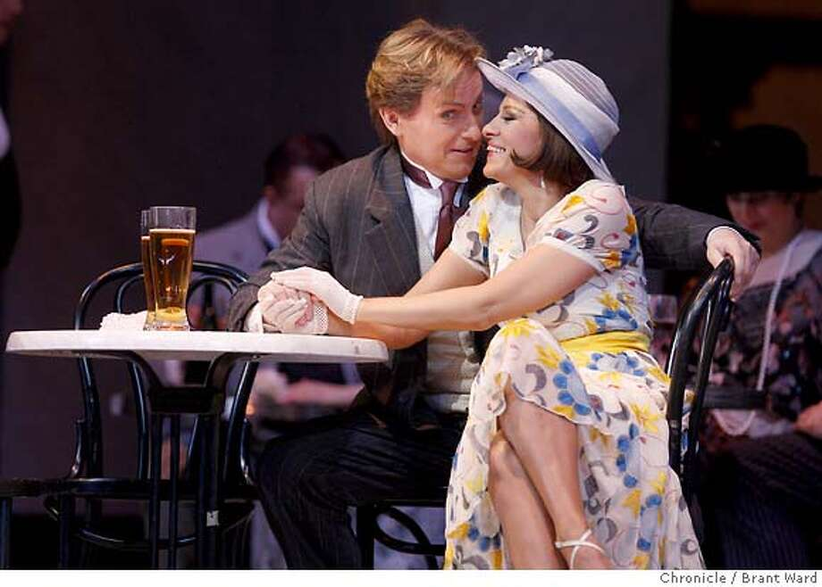 rondine_438.JPG  Misha Didyk as Ruggero, left, woos Angela Gheorghiu as Magda in the second act.  SF Opera presents La Rondine at the War Memorial Opera House.  {By Brant Ward/San Francisco Chronicle}11/4/07 Photo: Brant Ward