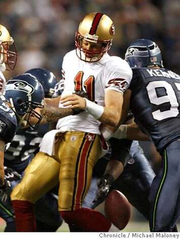 San Francisco 49ers quarterback Alex Smith (11) is sacked and loses the ball in the 1st quarter. Seattle recovered.  The Seattle Seahawks host the San Francisco 49ers in a Monday night football game at Qwest Fleld in Seattle.  Photo taken on 11/12/07, in Seattle, WA.  Photo by Michael Maloney / San Francisco Chronicle  ***Code replacement/roster MANDATORY CREDIT FOR PHOTOG AND SF CHRONICLE/NO SALES-MAGS OUT Photo: Michael Maloney