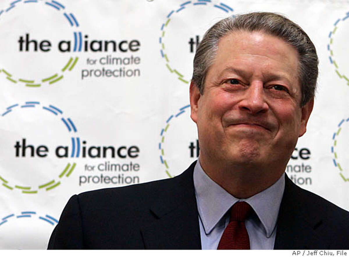 ** FILE ** Former Vice President Al Gore smiles after speaking at a news conference in Palo Alto, Calif., in this Oct. 12, 2007 file photo. Gore on Monday, Nov. 12, 2007 announced that he's joining Silicon Valley's most prestigious venture capital firm to guide investments to combat global warming. (AP Photo/Jeff Chiu, file)