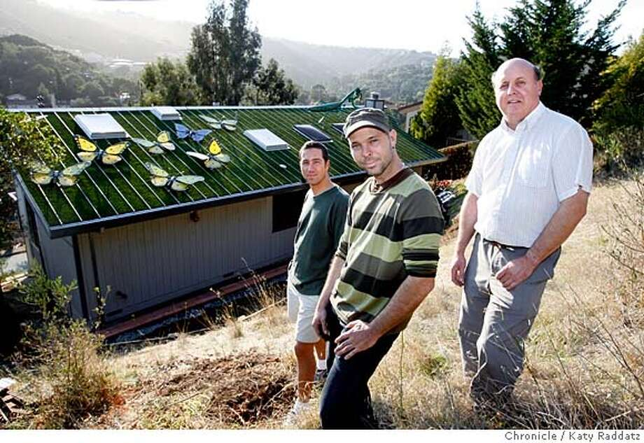 GOODNEIGHBORxx  L to R: Dem Pilafian. Patrick E. John McIntyre. The famous roof is just behind them. John McIntyre's neighbor up the hill, Dem Pilafian, once complained about the glare from John's aluminum roof, so McIntyre had a solution: artificial grass, butterflies, and a praying mantis. The sculptures are of glass, plexiglass, and made by Patrick E. These pictures were made on Thursday Oct. 25, 2007, in San Carlos, CA.  KATY RADDATZ/The Chronicle Photo taken on 10/25/07, in San Carlos, CA, USA Photo: KATY RADDATZ