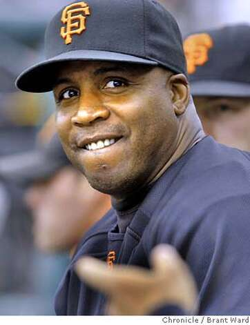 giants_268.JPG  Barry Bonds listened to teammates as he sat on the bench during Sundays game.  San Francisco Giants action against the Cincinnati Reds at AT&T Park Sunday including photos of Barry Bonds on the bench with a toe injury.  {By Brant Ward/San Francisco Chronicle}9/23/07  Ran on: 09-26-2007  Bonds probably won't be sharing the stage with Britney Spears tonight in his last home game with the Giants.  Ran on: 09-26-2007  Barry Bonds probably won't be sharing the stage with Britney Spears tonight in his last home game with the Giants.  Ran on: 09-26-2007  Bonds probably won't be sharing the stage with Britney Spears tonight in his last home game with the Giants. Photo: Brant Ward