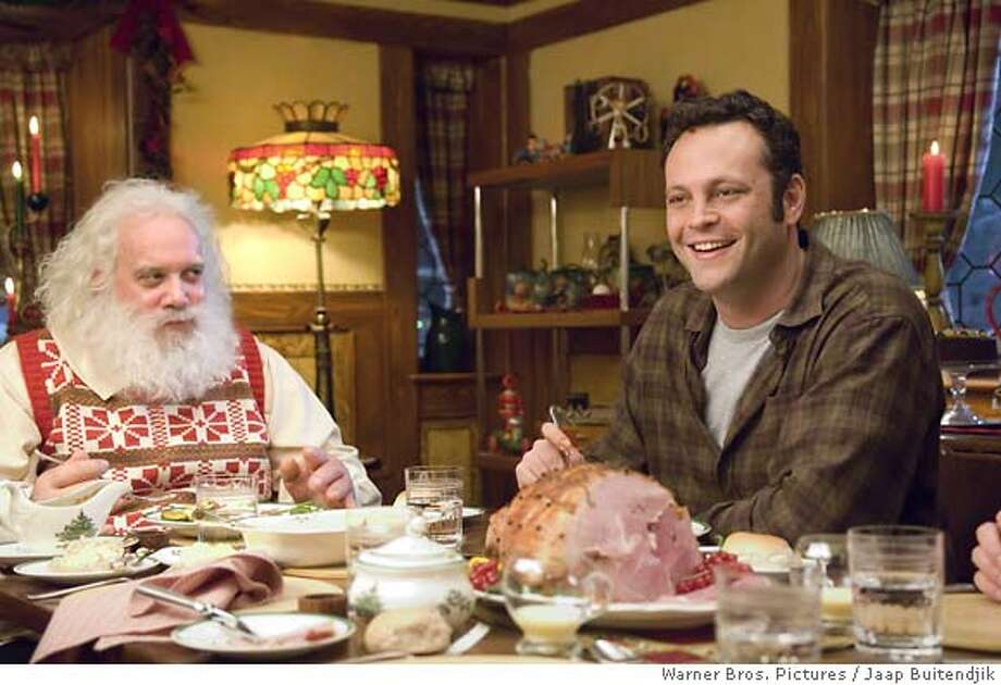 "This photo provided by Warner Bros. Pictures shows Paul Giamatti, left, and Vince Vaughn during a scene from ""Fred Claus."" Over the years Santas have ranged from naughty to nice, from Edmund Gwenn's portrayal of Kris Kringle in ""Miracle on 34th Street,"" to Billy Bob Thornton's gutter-mouthed drunk in ""Bad Santa."" The latest incarnation comes courtesy of Paul Giamatti, playing Santa opposite Vince Vaughn as the fat man's black-sheep brother in ""Fred Claus."" (AP Photo/Warner Bros. Pictures, Jaap Buitendjik) Ran on: 11-09-2007  Paul Giamatti plays St. Nick and Vince Vaughn is his black-sheep brother, who pays him a visit at the North Pole, in &quo;Fred Claus.&quo; Photo: Jaap Buitendjik"