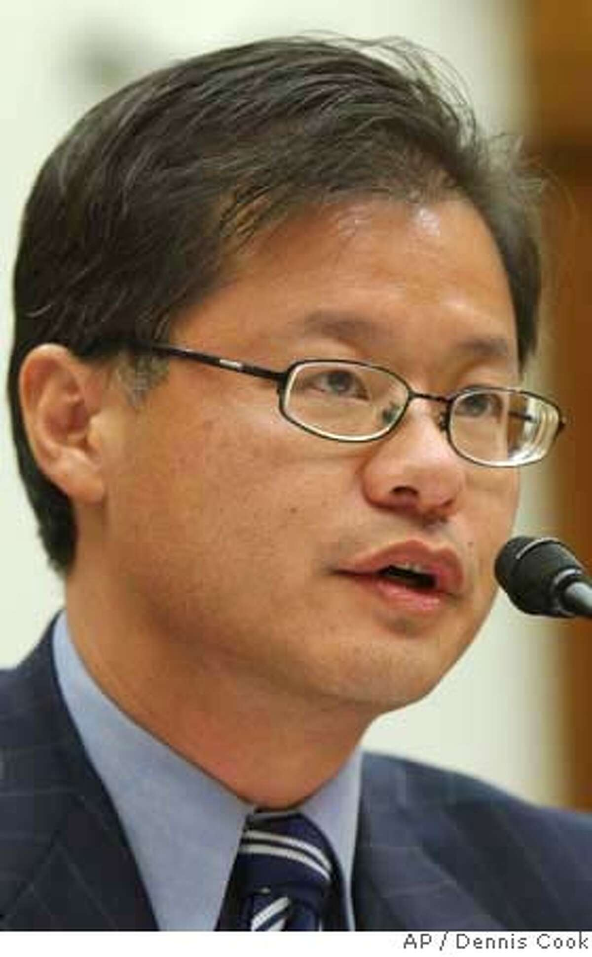 Yahoo Chief Executive Jerry Yang testifies on Capitol Hill in Washington, Tuesday, Nov. 6, 2007, before the House Foreign Affairs Committee. (AP Photo/Dennis Cook)