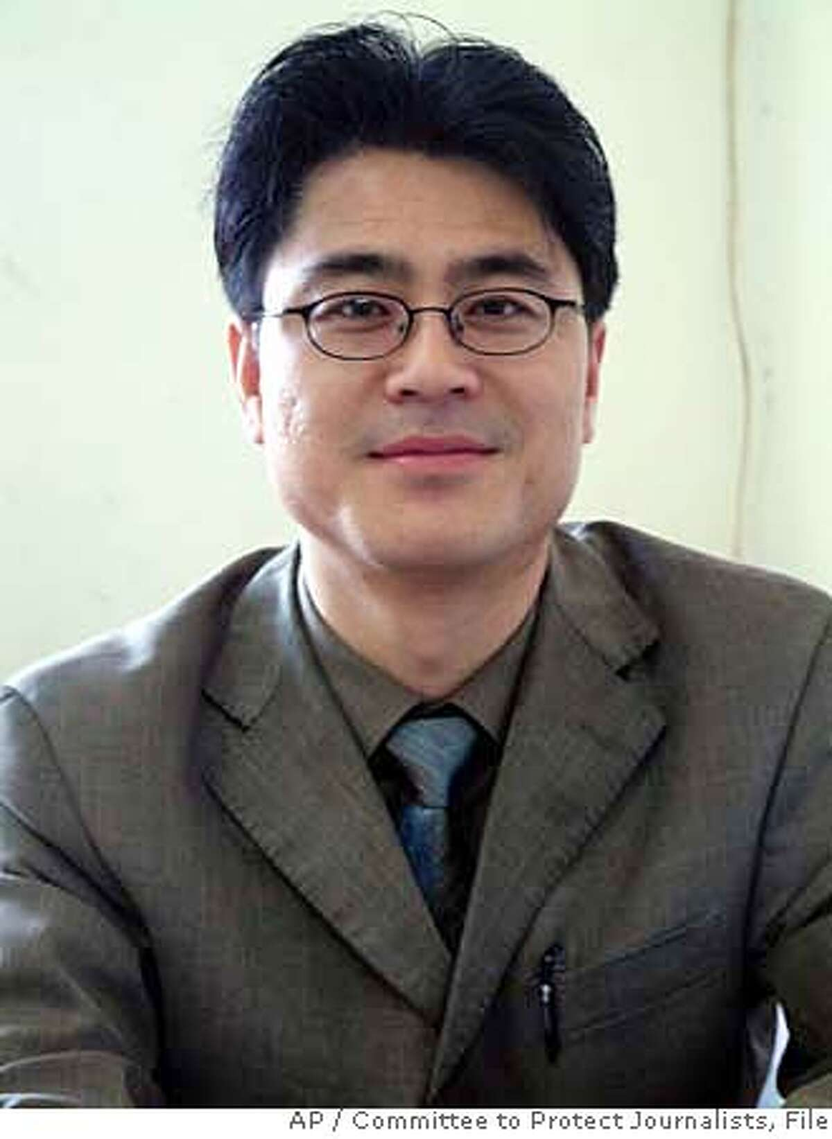 *** FILE *** This undated file photo, released on Nov. 22, 2005 by the Committee to Protect Journalists (CPJ) shows Shi Tao, a freelance journalist for Internet publications and an editor for the Chinese business newspaper Dangdai Shang Bao. A House committee chairman Monday Nov. 5, 2007 angrily rejected Yahoo Inc.'s explanation for why it provided incomplete information to Congress about its role in the arrest of a Chinese journalist.